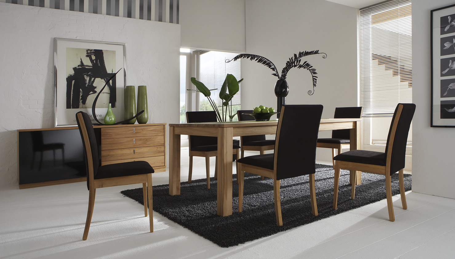 Fashion-furniture-design-for-equipment-of-modish-dining-room-black-chairs-with-wooden-foots-wooden-dining-table-cabinet-vases-and-carpet